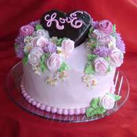 Buttercream Flowers Iced with buttercream and roses, mums and dogwood arrangement all from buttercream. Heart chocolate cake with chocolate ganache,...