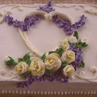 Victorian Valentine Sheet cake iced and decorated with buttercream. Overpiped heart. Buttercream roses and violets.