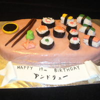 Sushi Caki carrot cake w/cream cheese icing covered in marbled mmf with sushi made from rkt. Made for my 19yr old son's birthday. Banner is mmf...