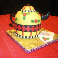 "Mary Englebright Tea Pot Cake Made from wilton ball pan and a 6"" round in the middle covered in MFF, handle and spout is gumpaste. Napkin is fondant."
