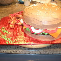 "Hamburger And Fries buns are 8"" round vanilla cakes. Hamburger patty is a brownie. fries are pieces of cake that were broiled on all sides. fixin's..."