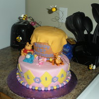 "Whinnie The Pooh Cake figures are all fondant10"" white velvet chocolate chip cake, 3 6"" cakes carved to make hunny pot."