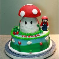 Trevor's 6Th B.d Mushroom is RKT with a half round cake as cap, MMF accents, bc frosting. TFL!