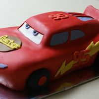 Lightning Mcqueen This is my DH's 2nd ever decorated cake. He's not too happy with how it turned out though.