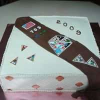 Girl Scouts Sash With Badges For the girl scouts end of the year celebration. A sash with the badges that they emailed me. The badges were made out of fondant/GP and...