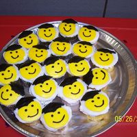 Smiley Grad Cupcakes These cupcakes were made for my daughter's pre-school graduation....the smiley faces were the FBCT (??)....