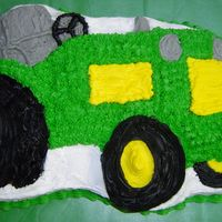 Tractor Cake 1st Tractor cake that I have done. Was sick with the flu all week so wasn't able to give this cake 110% but I did my best.