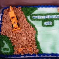 Construction Birthday Cake Boy's 1st Birthday Party. The dirt road is made of graham crackers.