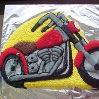 Motorbike Cake I made this cake from a Wilton shaped pan, for my father-in-law on Fathers Day.He was very pleased with it.:)