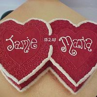 Two Hearts Joined I made this cake for a friends anniversary.I was pleased with the result.I cut out the hearts freehand,and made the design up as I went...