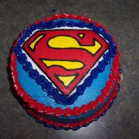 Superman   3 layer checkerboard cake, buttercream icing, superman logo is fbct