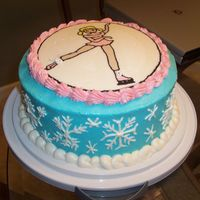 Snowflake Cake Yellow cake with buttercream icing, ice skating girl was a FBCT.