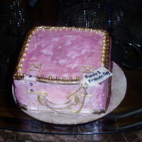 Pink Suitcase   6x6x4 Yellow cake cover in rolled fondant. Painted pink and gold with edible gold balls.