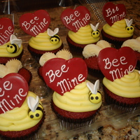 Bee Mine Cupcakes Red Velvet cupcakes. Some topped with iced bee hives, royal icing heart, and a fondant bee. Others iced with buttercream heart. Thanks for...