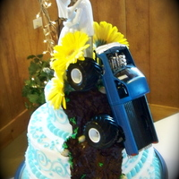 Red Neck Wedding Cake Two in one... Beautiful aqua swirled bridal cake on one side, Red Neck Mud Bogging Grooms cake on the back side