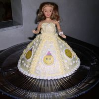 Smiley Face Doll Cake This was for my Daughter's 4th BDAY...She had a smiley face theme...did matching cupcakes with smile face rings on them.
