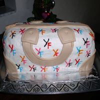 Purse Handbag My First One!!! So Much Fun! I loved doing this cake! It was so much fun...It was for my mother in law. I used her initials. Thanks so much for the tutorial on this...