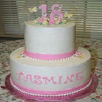Tasmine's 18Th Birthday Cake 10 and 6 inch tiers. WASC with strawberry and Lemon curd fillings. Buttercream Dream frosting.