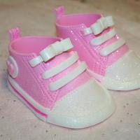 Baby Converse Shoes These are my first little converse shoes, going on a baby shower cake this weekend. Instead of using the star I used a little heart, and I...