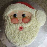 Santa Claus  I made this cake for my daughter's ballet class Christmas party. Santa's face, is fondant and his beard and the white of his hat...