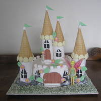 Castle Cake First ever castle cake- not as hard as I thought. Cake is chocolate with sugarpaste icing. Turrets are gelain icing tubes (also a first)....