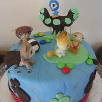 Littlest Pet Shop A chocolate cake covered in fondant. This was my 8 year old daughters first decorating attempt for her birthday- with a little help from...