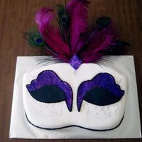 Masquerade March 2008 - I made this masquerade mask for theme birthday party...all fondant accents, feathers from Michael's and the silver detail...