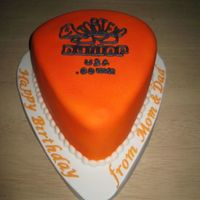 December 2007 - Guitar Pick I made this cake for my boyfriend's brother's birthday. He plays guitar and I made the cake to look like the picks he uses. The...