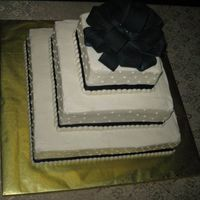 "December 2007 - Square Wedding Cake This was the most simple wedding cake I've made in a while. The bow is the Wilton 6.5"" bow, painted black (what a hassle!). She..."