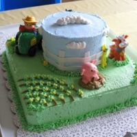Farm Birthday BC with fondant fence. I used little people farm animals to save time in decorating. Thanks to similar cakes here on CC for inspiration.