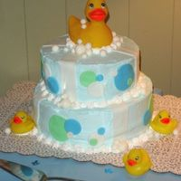 Everything's Ducky--Baby Shower This cake was inspired by others from cc. BC with fondant accents. The ducks are just purchased bath toys.