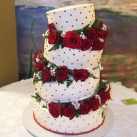 Tilted Red Roses Cake  This cake is made with whipped cream in ivory and it has Black Magic Roses in between tiers. The family loved it so much that they took a...