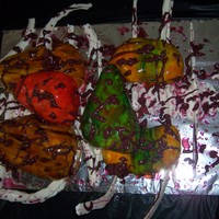 Bloody Thorax Cake Heart, lungs, kidneys and liver made of cake and covered in MMF. White chocolate ribs and spine