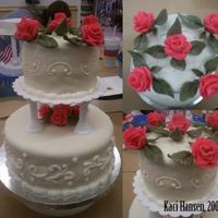 First Tiered Cake First tiered cake. A lot of work! Had a few problems with the cake collapsing, but I still think it came out pretty good. All roses and...