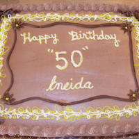 Eneida's Birthday Cake Called this Almond joy cake... chocolate and coconut cake with ganache and almonds in the middle.
