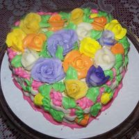 Heart Shaped Cake/diff Colored Flowers I made this heart shaped cake for my cousin who at the time was having chemo for breast cancer so i thought to do this with lots of bright...