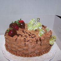 Fresh Fruit/chocolate Cake  This cake was done for one of my friends his sister had passed away and they love chocolate and fruit so this was what i came up with it...