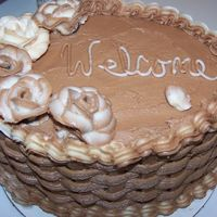 Welcome Cake  This cake was made for some race fans that rented my daughters house for the weekend, all chocolate with white and chocolate icing mix...