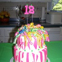 100_0403.jpg   All buttercream except fondant accents the stripes and numbers , curly ribbon ,