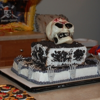 Halloween Party, sheet cake, white with bc icing, the top cake is a sheet cake cut in half with strawberry filing, and crushed up oreos for the dirt,