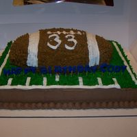 Foot Ball Cake all bc was a hoot to make heavy too wanted his jersey# on the football football was all chocolate field was yellow cake chocolate icing