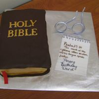 Bible Cake....  Bible made from chocolate cake covered in ganache and then covered in chocolate clay. Glasses, and paper made from gumpaste painted with...
