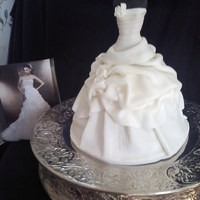Wedding Dress Cake Made to replicate the brides dress. Pound cake underneath, dress form is a dismembered Barbie :/ wrapped in fondant.