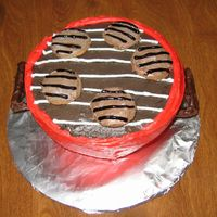 Weber Grill Cake When I think of the 4th of July I think of a barbeque with my family! My cake is a chocolate cake with chocolate filling. The grill is made...
