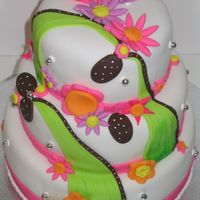 Flower Fantasy   Vanilla and chocolate cake coverered with fondant, everyhing is made with fondant. Thank you for looking.