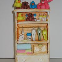 Baby Wardrobe This is work on progress, for a Baby shower, everything is made out of sugar, except the wire of the hangers and the wood of the closet. I...