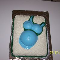 "Pregnancy Cake This was the first Maternity Cake I have ever done. I used homemade Marshmallow Fondant for the ""shirt"" and buttercream for the..."