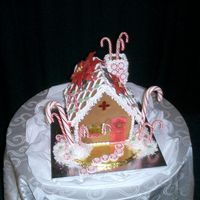 Candy Cane Cottage This homemade gingerbread house has candy windows, fondant poinsettias, and lots of peppermint candies! Dusted with white sparkle dust and...
