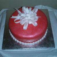 Holiday Cake - Red Fondant red fondant with a white bow - covered with touch of red pearl and white sparkle