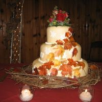 Fall Wedding Cake Ivory Fondant Wedding Cake decorated with rice paper leaves and fresh flower topper.